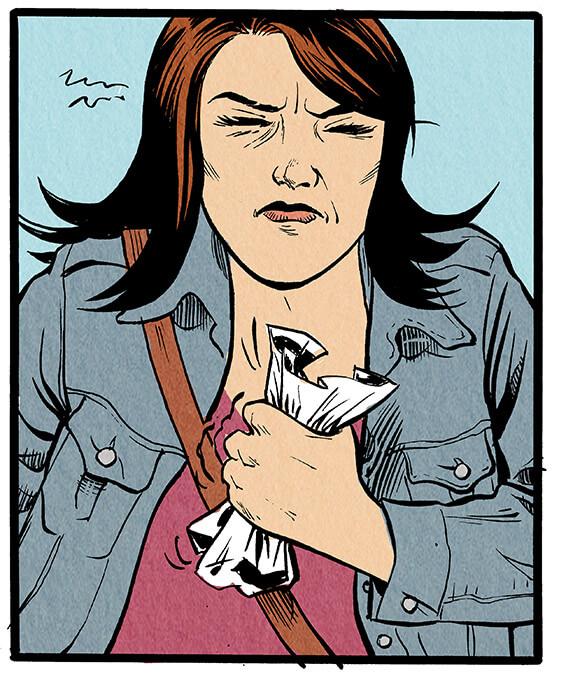 Anna Wegener kneift die Augen zusammen und versucht tapfer, sich die Belästigungen nicht zu Herzen zu nehmen. Sie ist jedoch sichtlich angewidert und hat die Hand mit einem Papier darin zur Faust geballt.