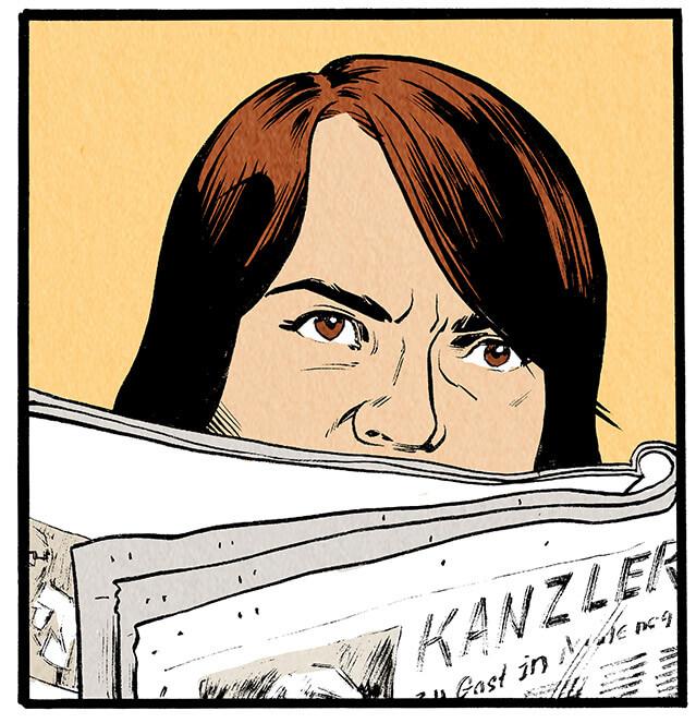 Anna Wegener blickt empört von der Zeitung auf.